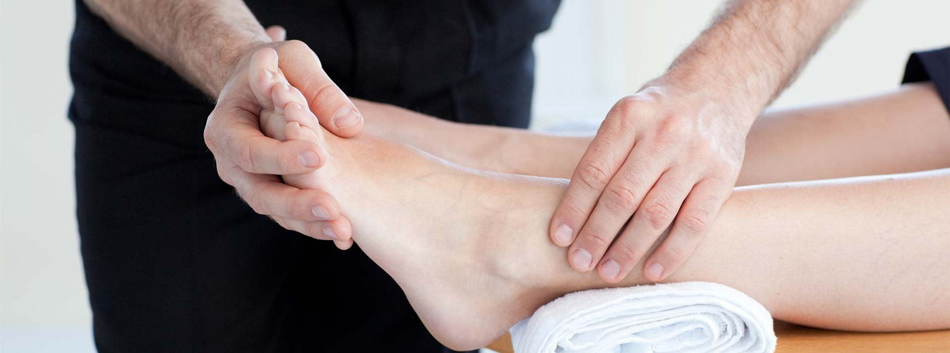 podiatrist assessing foot