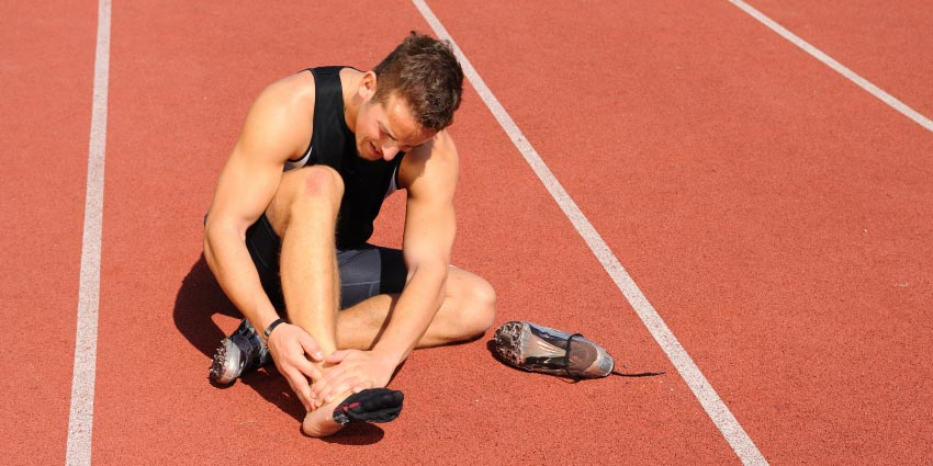 athlete with injured foot